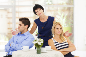 mother feeling helpless caught in between young couple fighting